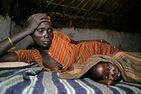 Mother and sick child in a camp for displaced, Southern Sudan