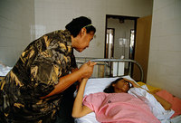 A mother visiting her daughter who is dying of AIDS, Brazil