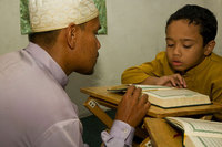 Private lessons learning to read the Koran, Malaysia