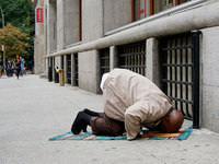 praying on the sidewalk in New York City