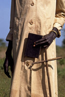 Christian  Sudanese Dinka with his bible and crucifix