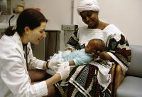 Pediatrician Dr. Sharon Levy with African mother and her infant at Bellevue pediatric hospital. New York