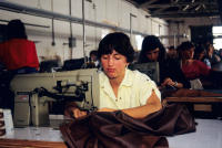 Women sewing clothing in a factory on the Mexico border.
