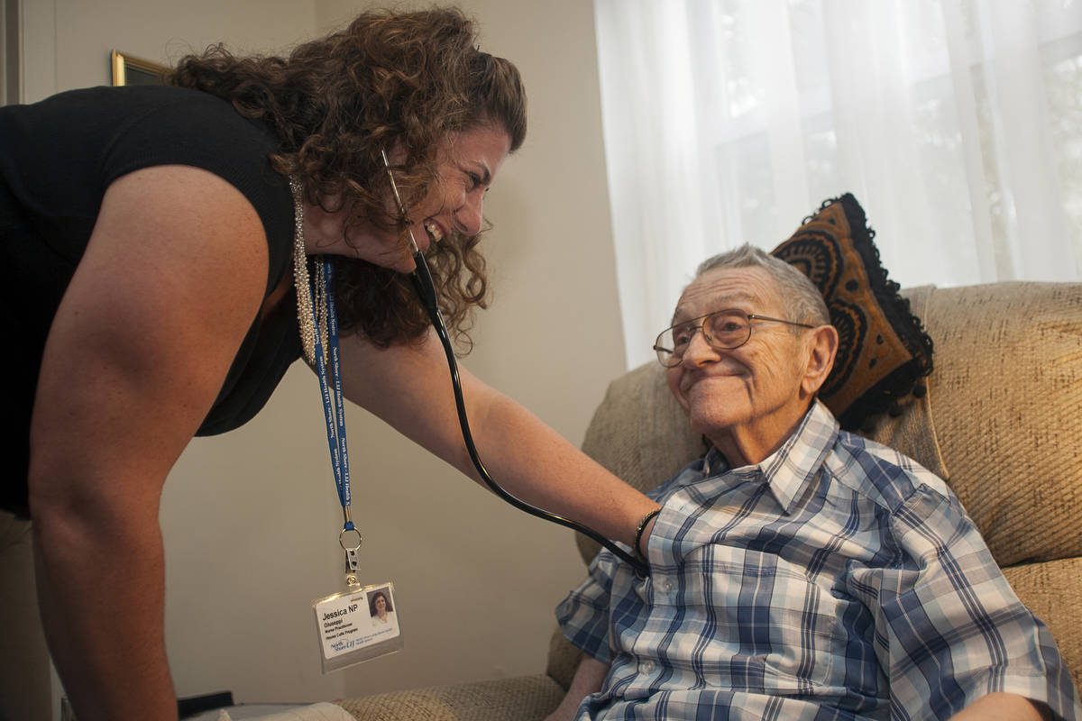 Nurse practitioner Jessica Giuseppi on her monthly visit to check on Robert, who can't walk and has problems speaking. : FEATURE: Doctors making Home Visits : Viviane Moos |  Documentary Photographer