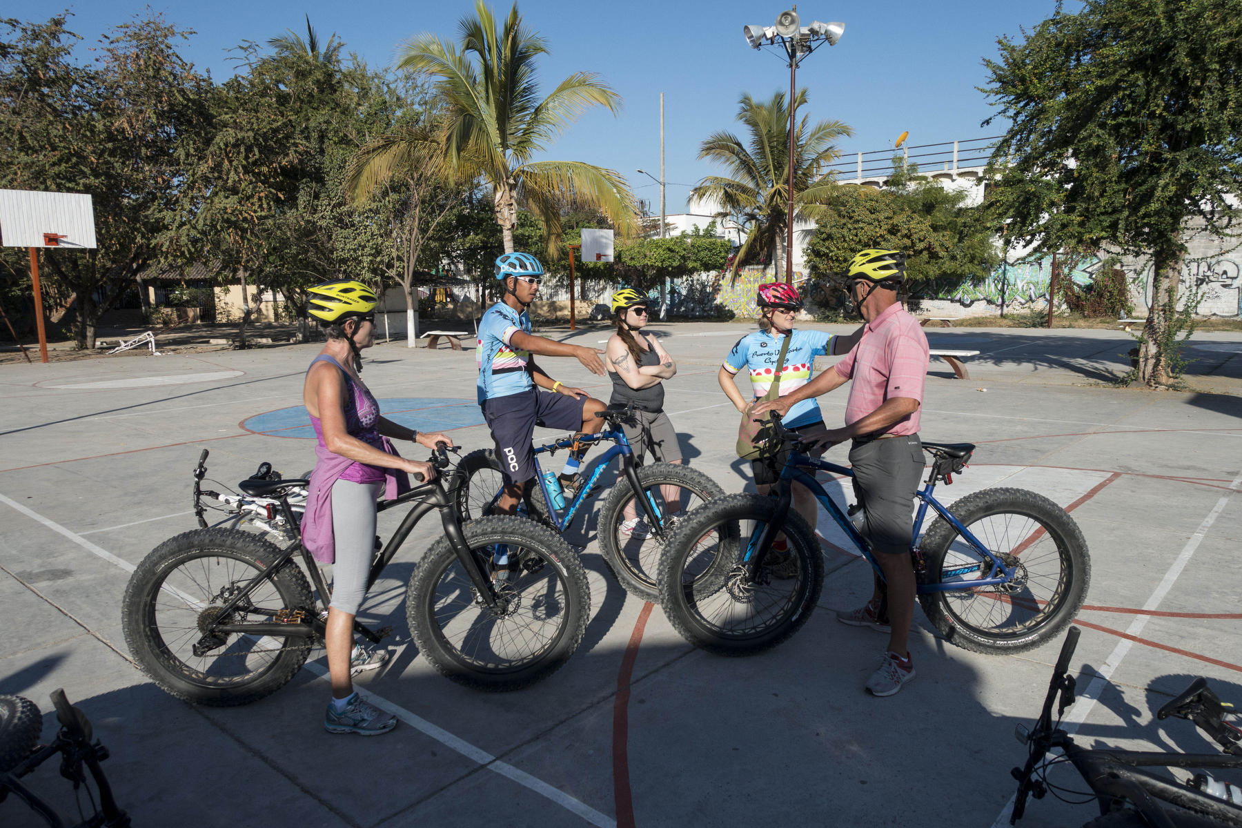 Bicyclists take a photography break  : PUERTO VALLARTA - Wall Art & Bicycle Tour : Viviane Moos |  Documentary Photographer