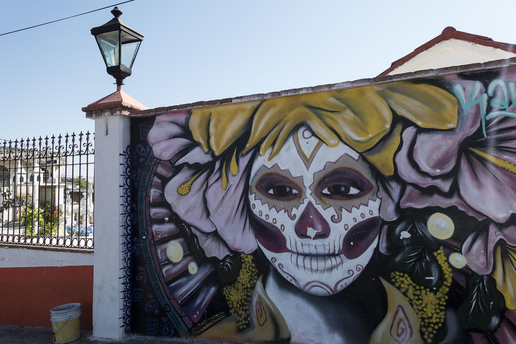 La CATRINA, symbol of The Day of the Dead on the wall of the cemetery.  : PUERTO VALLARTA - Wall Art & Bicycle Tour : Viviane Moos |  Documentary Photographer