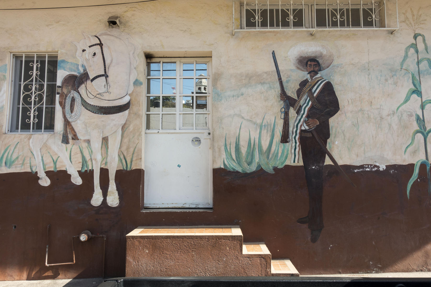 General Pancho Villa and his horse Seven Leagues painted on the side of a house in Old Town. : PUERTO VALLARTA - Wall Art & Bicycle Tour : Viviane Moos |  Documentary Photographer